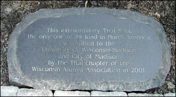 Plaque which reads: This extraordinary Thai Sala, the only one of its kind in North America, was gifted to the University of Wisconsin-Madison and City of Madison by the Thai chapter of the Wisconsin Alumni Association in 2001